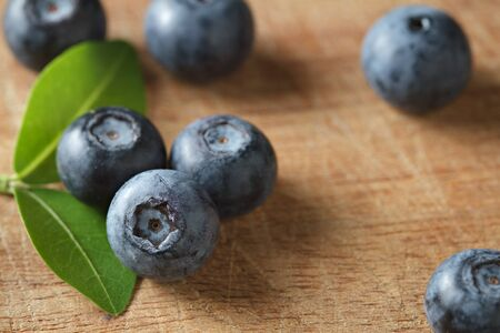 Blueberries on wooden. Blueberry contain antioxidant organic  useful healthy and nutrition. Banco de Imagens