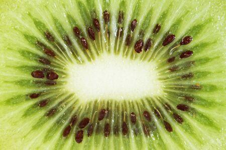 Slice of fresh kiwi fruit .