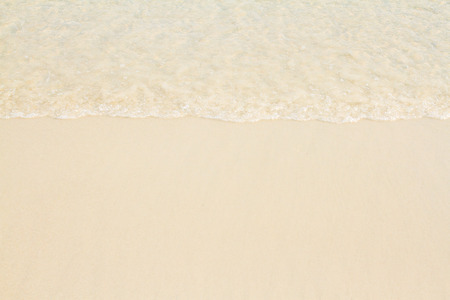 Wave of the sea and sandy beach. Stock Photo