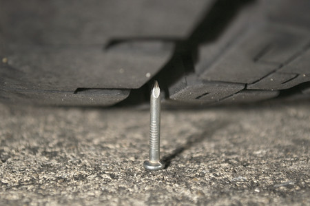 Tire meets nail photo