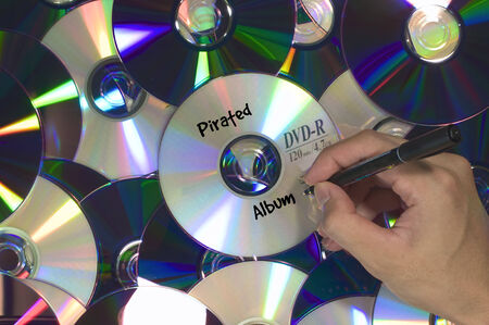 violated: Pirated song album DVD piled
