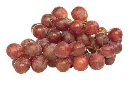 Bench of red grape isolated on white photo