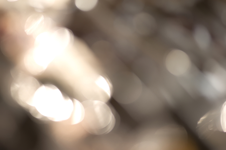 contrasty: Abstract contrasty blurry background with a lot of bright bokeh Stock Photo