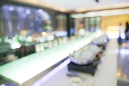 confortable: Abstract blurry food and drink counter restaurant with blurry unrecognizable people Stock Photo
