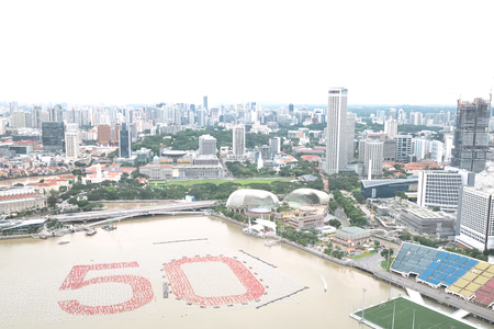 19 years: December 19, 2014 - Singapore: Singapore business zone cityscape with number 50 by using 20,000 white spheres and 5,000 red sphere over river to celebrate over 50 years of independence