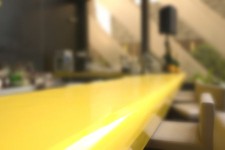confortable: Abstract blurry empty yellow counter of pub in early morning