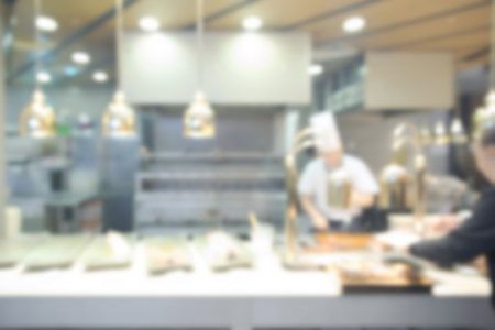 western food: Abstract blurry western food counter with chef cooking food