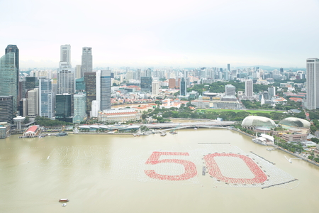 red sphere: Singapore business zone cityscape with number 50 by using 20,000 white spheres and 5,000 red sphere over river to celebrate over 50 years of independence Stock Photo