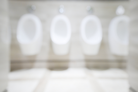 Abstract blurry clean men urinate bowl inside public rest room