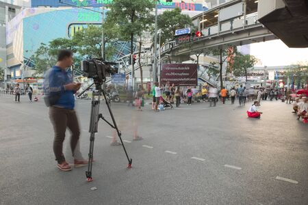 discovery channel: Bangkok, Thailand - January 14, 2015: Camera and Camera man from Thailand news channel recording Discover Thainess 2015 parade event at Pathumwan intersection