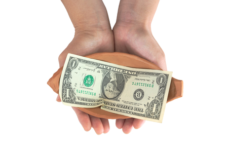 disparity: Woman hand holding pottery with single dollar note inside Stock Photo