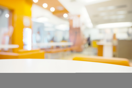 table surface: Abstract bright blurry restaurant background with few blurry unrecognizable customer
