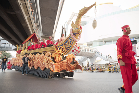red man: Bangkok, Thailand - January 14, 2015: Red man dragging large boat over pathumwan intersection in Discover Thainess 2015 event