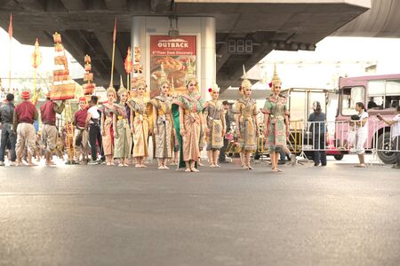 discover: Bangkok, Thailand - January 14, 2015: Group of Thai traditional dancers within parade prepare to move to stage in Discover Thainess 2015 parade event at Pathumwan intersection Editorial
