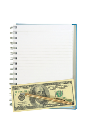 hard bound: Empty strip line notebook with twisted gold pen over 100 dollar note on bottom of page isolated on white background