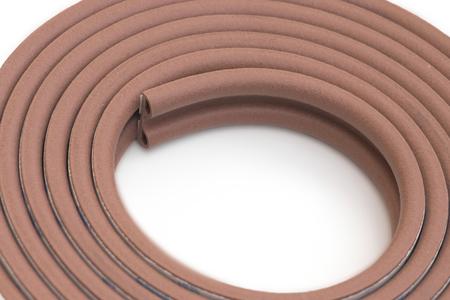 multipurpose: Roll of brown multipurpose sticking bumper over white background