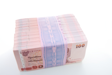 Seal pack of 10 packs of 100 of new hundredth baht notes worth 100,000 baht over white background