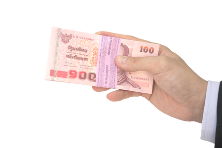 handling: Thai Male hand handling pack of 100 banknotes of 100 baht isolated on white