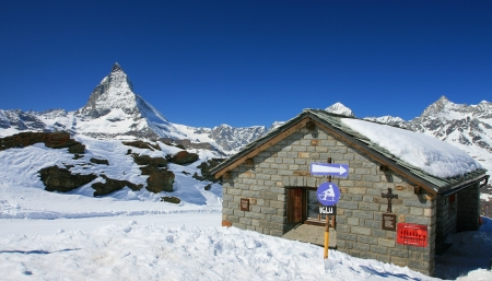 Small house with Matterhorn and blue sky in the background
