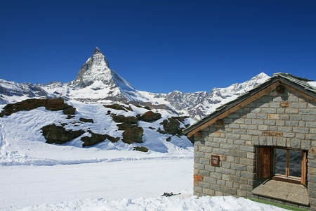 Small house with Matterhorn mountain in the background