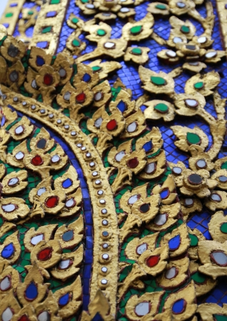 Beautiful detail of traditional Thai style on temple s door