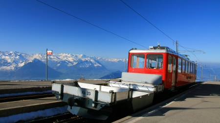 Swiss alpine cog rail train on the top of  mount Rigi