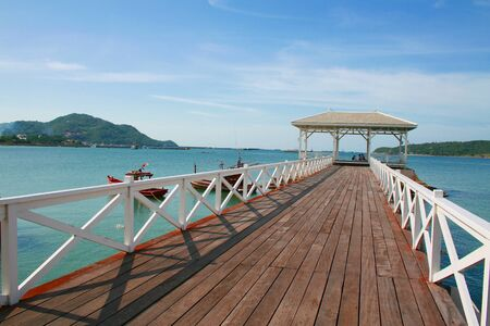 wooden jetty with pavilion to the sea at Srichang, Thailand