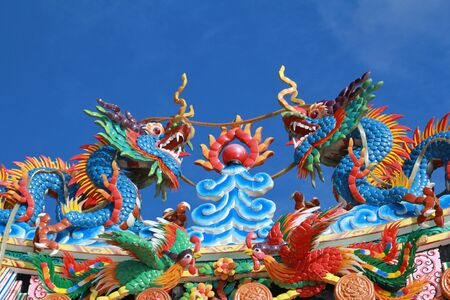 Statue of twin dragons on Chinese temple roof