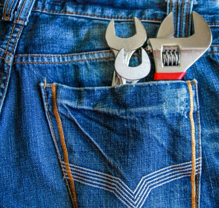 Mixed chrome wrench in jeans back pocket Stock Photo