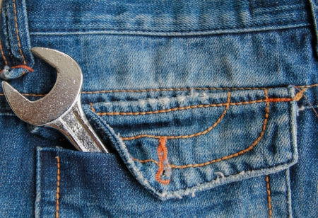 Fixed chrome wrench in jeans back pocket