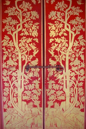 Old gold painting on red door photo