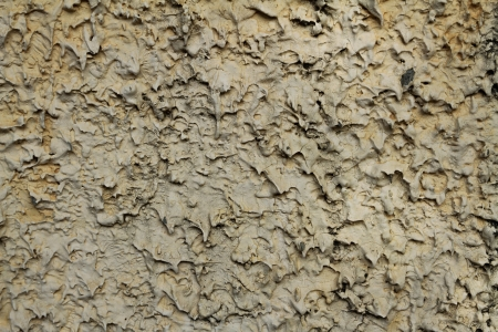Grungy beige concrete wall background