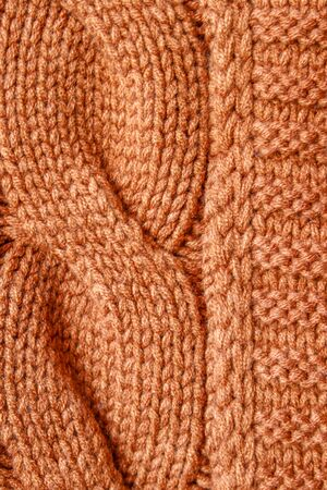 Orange knitted wool texture photo