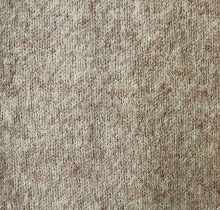 Beige knitted wool background photo