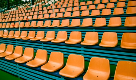 Orange empty plastic seats pattern