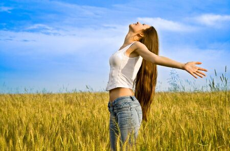 Young happy woman in field photo