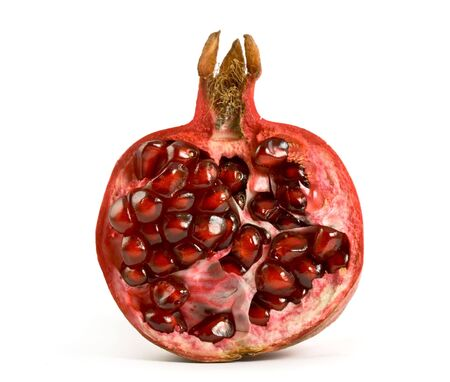pomegranate juice: Half of pomegranate on white background Stock Photo