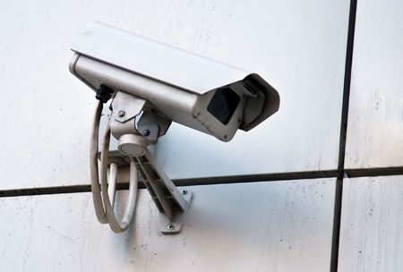 supervision: Camera of external supervision on wall Stock Photo