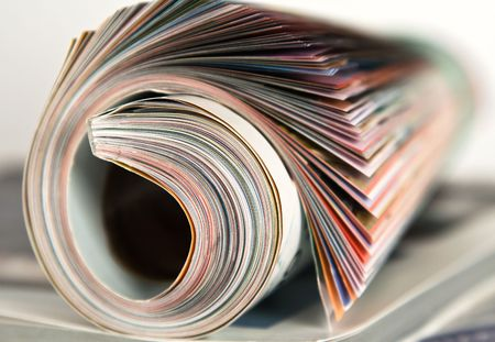 Roll of magazine on isolated white background Stock Photo - 3102754