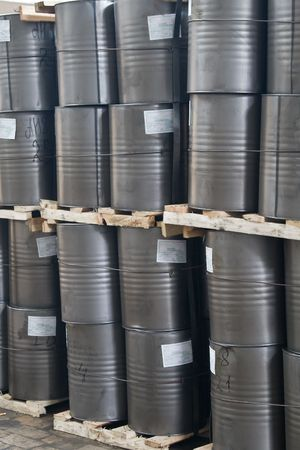Pallets with barrels in a warehouse photo