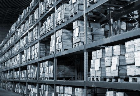 store shelf: Industrial warehouse with plenty of boxes. Black and white photo