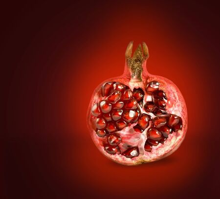 Half of pomegranate on red background photo