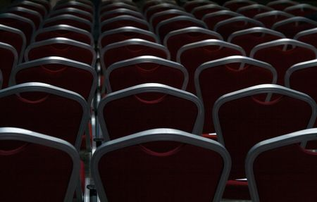 Empty chairs in a dark big conference hall Stock Photo - 3362928