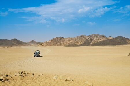 sandhills: Landscape of desert with jeep
