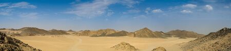 sandhills: Panorama of desert and hills with blue sky Stock Photo