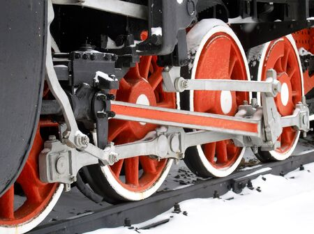 Red wheels of old locomotive photo