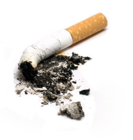 fire damage: Cigarette Stock Photo