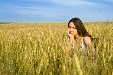 Young woman in field photo