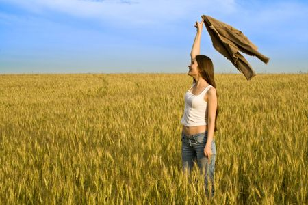 Young woman in wheaten field with jacket photo