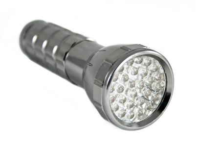 Handy torch with LED on white background photo